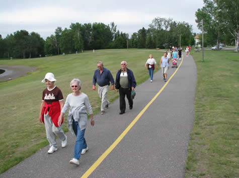 Group of people walking on a trail