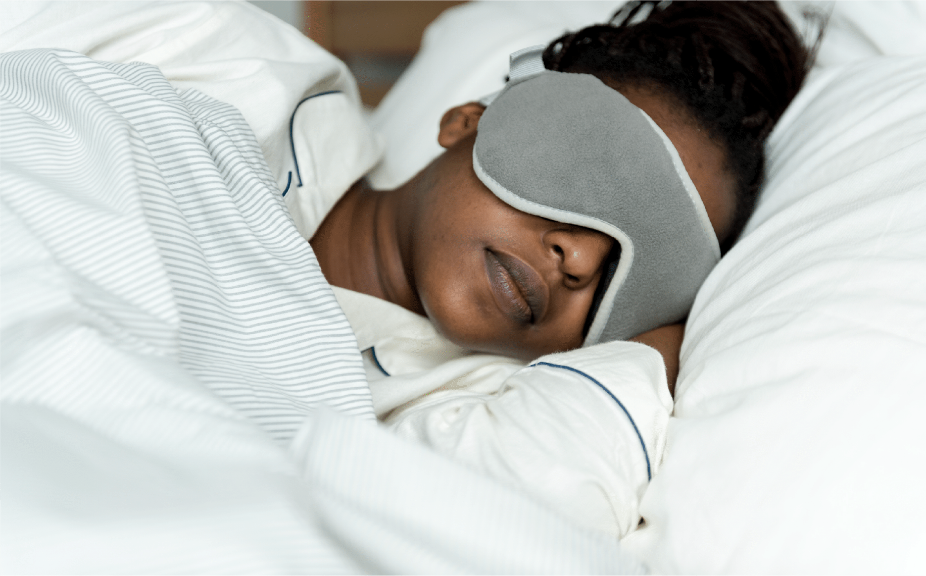 Women sleeping with a facemask on