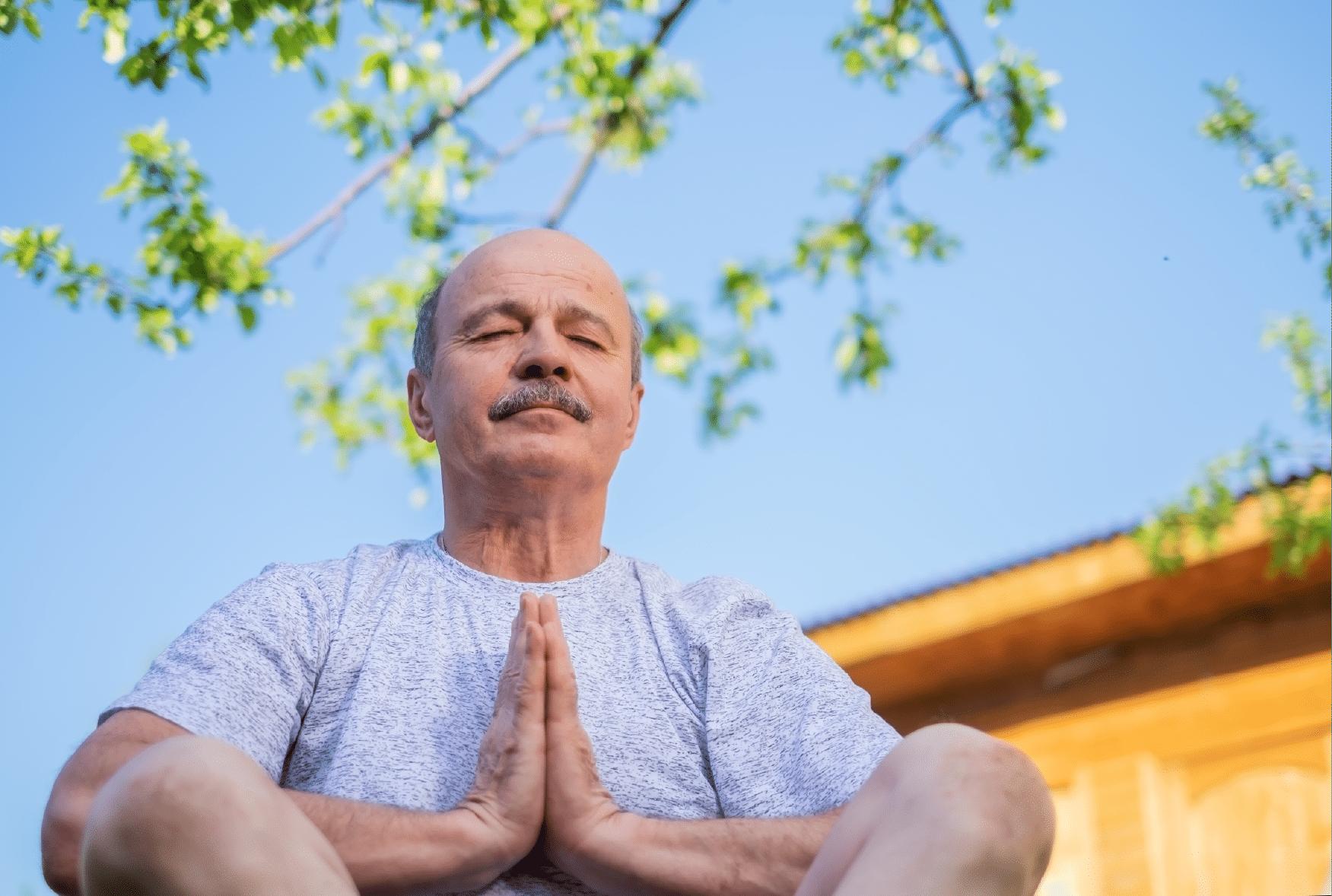 An older gentleman meditating
