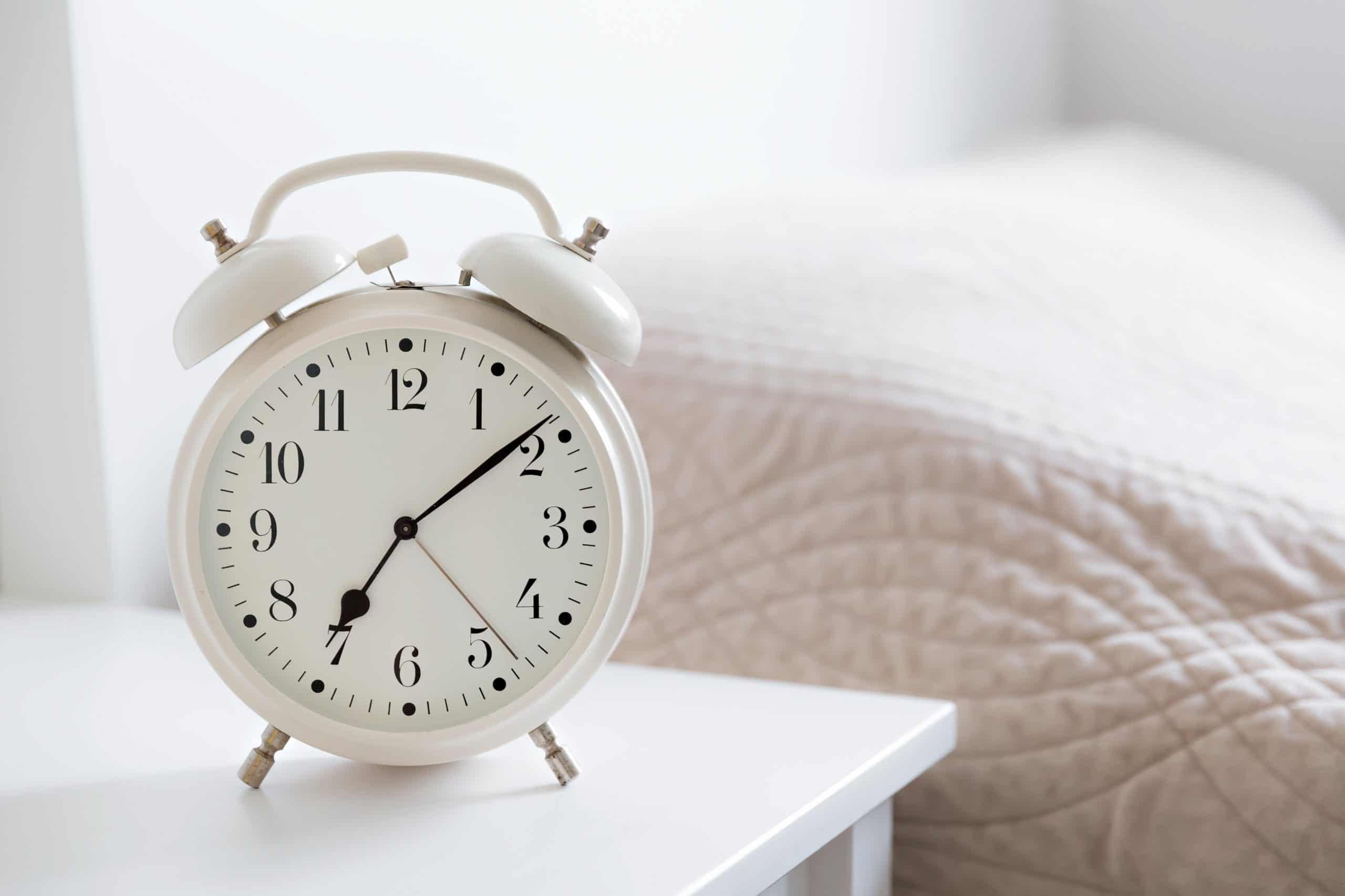 Alarm clock in a white bedroom