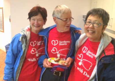 Three women smiling with food from Chartwell home in Thunder Bay