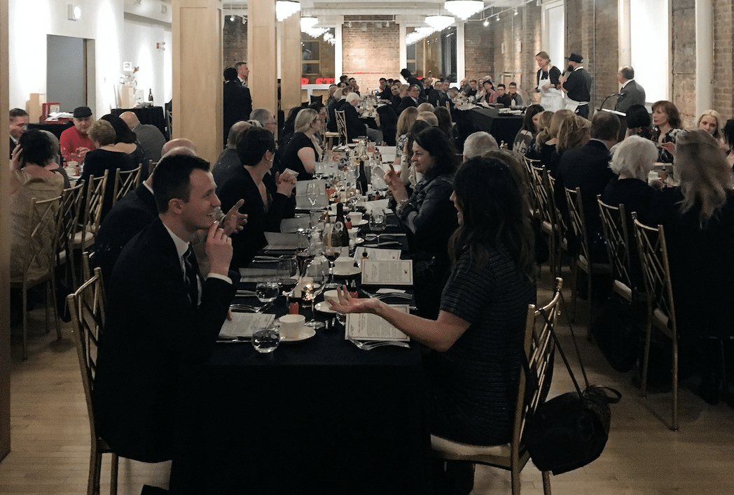 group of people eating diner at a restaurant